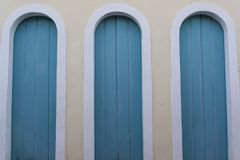 Three doors, Lençóis, Chapada Diamantina, Bahia, Brazil. Three identical blue doors in a symmetrical composition, Lençóis, Chapada Diamantina, Bahia stock photography