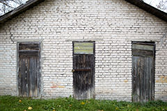 Three doors in the old garage. Royalty Free Stock Photos