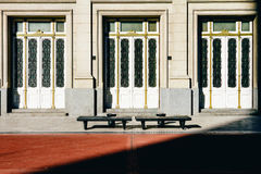 Three doors with two concrete benches. And shadow stock images