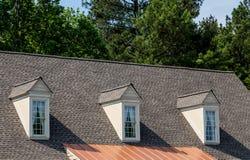 Three Dormers over Asphalt and Copper Stock Photos