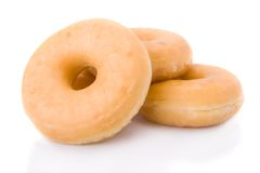 Three doughnuts or donuts isolated Stock Images