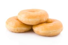 Three doughnuts or donuts piled Stock Photo