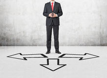 Three drawing arrows. Businessman standing on a three drawing arrows Stock Photography