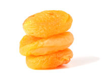 Three dried apricots. On the  background Royalty Free Stock Images