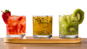 Three drinks made with passion fruit, strawberry and kiwi Caipir Stock Images