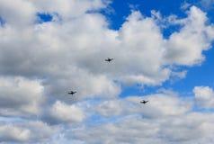 Three drones. In a blue sky stock photos