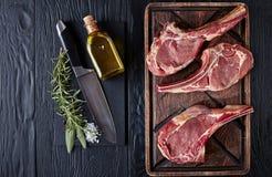 Three Dry aged raw tomahawk beef steaks