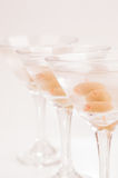 Three Dry Martini Cocktails close up over light purple background Stock Photography
