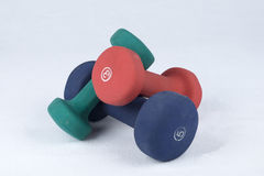 Three dumbbells piled up Royalty Free Stock Images