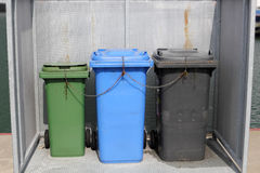 Three dustbins in a box Stock Photography