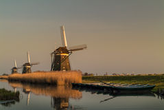 Three Dutch historic windmills in a row Stock Image