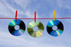 Three dvd and cd disks and sky Royalty Free Stock Photos