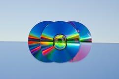 Three dvd discs on mirror Stock Photo