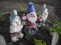 Three dwarf with lantern. Three little dwarf with lantern in the garden Royalty Free Stock Images