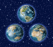 Three Earths B. Illustration of three earth views arranged in a triangle against starry sky Stock Photo