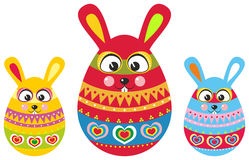 Three easter bunny in easter eggs Royalty Free Stock Images