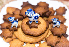 Three Easter china lambs on the plate with ginger cookies. Three Easter china lambs on the plate with handmade ginger cookies Royalty Free Stock Image