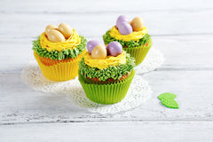 Three Easter cupcakes Stock Photography