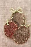 Three Easter Egg Shaped Stitched Canvas Stock Photography
