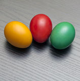 Three Easter eggs. On wooden background Royalty Free Stock Image