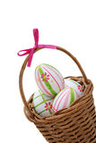 Three Easter eggs in a basket from corner Stock Photo