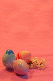 Three Easter eggs with blossoming apricot twig on pink Stock Image