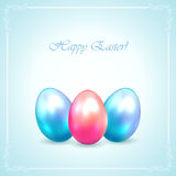Three Easter eggs on blue background Royalty Free Stock Images