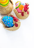 Three Easter eggs chicken basket. Three decorated easter eggs in basket isolated Stock Images