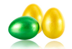Three Easter eggs close-up. Three Easter eggs with gold and green isolated on white background Royalty Free Stock Images
