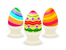 Three easter eggs on cups isolated Royalty Free Illustration