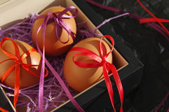 Three Easter eggs are decorated bright with color tapes Stock Photo
