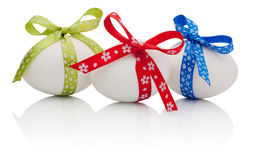 Three Easter eggs with festive bow isolated Stock Image