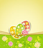 Three Easter eggs and flowers Stock Photography
