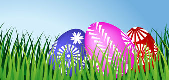 Three Easter eggs in grass. The picture of three color Easter eggs in green grass Royalty Free Stock Photo