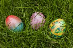 Three Easter Eggs in grass. Tie-dyed Three Easter Eggs in grass royalty free stock images
