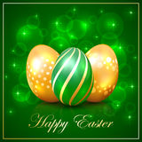 Three Easter eggs on green background Stock Images