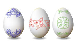 Three Easter eggs with hand drawn blue, red and green pattern Royalty Free Stock Images