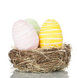 Three Easter eggs in a nest Stock Images