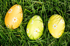 Three easter eggs nestled in the grass Royalty Free Stock Photo