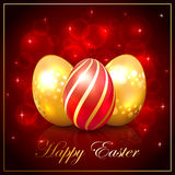 Three Easter eggs on red background Royalty Free Stock Photos