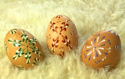 Three Easter eggs on the sheepskin Stock Images