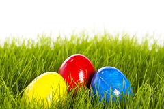 Three easter eggs with soft focus in grass Royalty Free Stock Photography