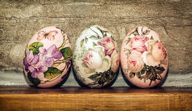 Three Easter eggs stacked on the wooden base, Easter holiday stock photos