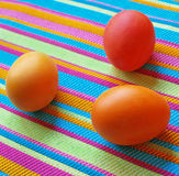 Three easter eggs on the striped fabric Royalty Free Stock Photo