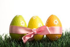 Three easter eggs wrapped in pink ribbon Royalty Free Stock Photography