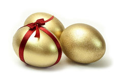 Three Easter Gold eggs Stock Photo