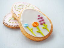 Three easter sugar cookies decorated with royal icing. Ester treat upon wooden table. Stock Photography