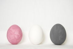 Three easter white grey pink eggs Royalty Free Stock Image
