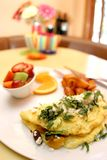 Three egg omelette. With fresh fruit royalty free stock photos