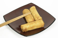Three Egg Rolls And Chopsticks Royalty Free Stock Photos